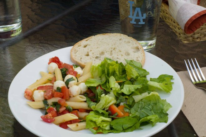 Summer pasta salad with green salad and French bread.