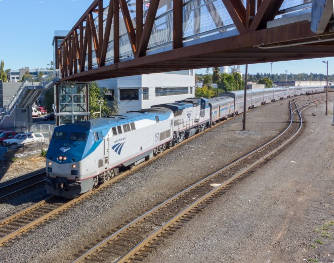 Amtrak's Coast Starlight  running under the new pedestrian bridge in Southeast Portland