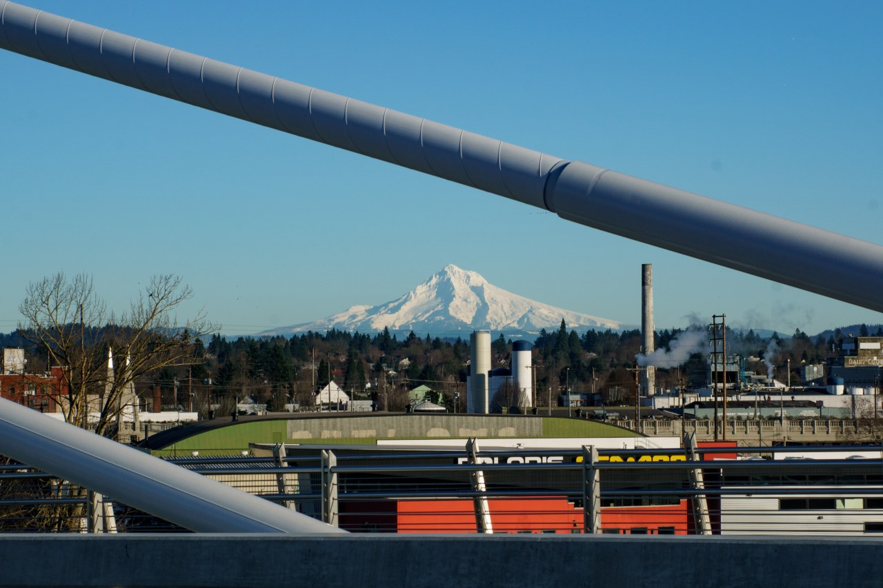 Mount Hood as seen through suspension cables on Tilikum Crossing