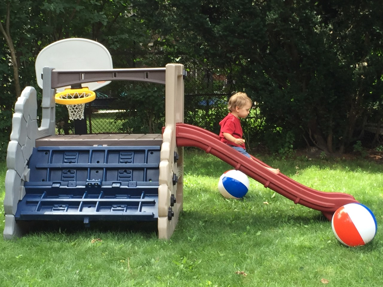 J. on his play structure in the backyard