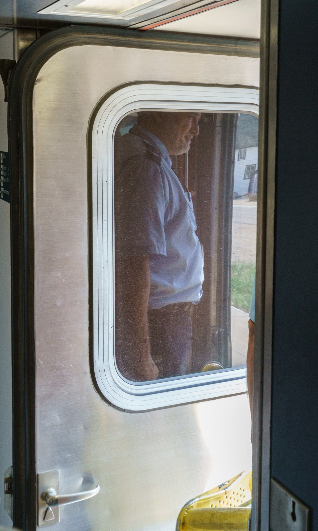 Sleeping Car Attendant (Dennis) at the door as we pull into a station.