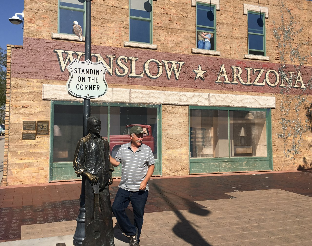 Standin' on a corner in Winslow, Arizona with the artist Ron Adamson