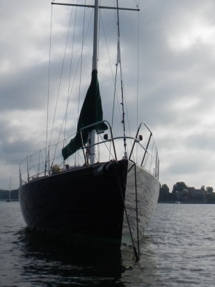 Shiny hull reflects the ripples
