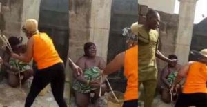 Nigerian woman flogs lady she caught sleeping  with her husband