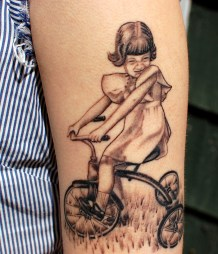 mom on tricycle portrait tattoo