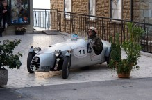 1938 Fiat racer and its driver who is probably also from 1938.