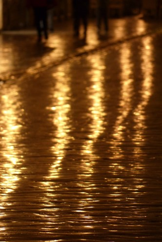 Wave of light on the rain soaked Stradun, the main street in Dubrovnik's old city.