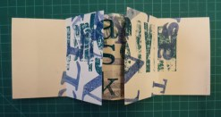 folded to book form after cuts