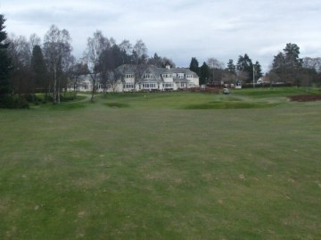 18th Green with clubhouse in the background.