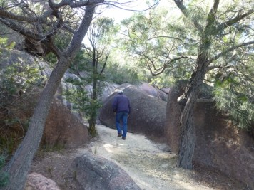 Path still going up, betwen granite boulders.