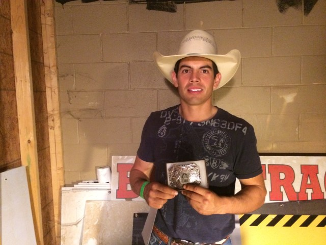 PBR at Cowboys Dancehall-May 10. 2014 Event Winner Gustavo Pedrero with his Buckle.