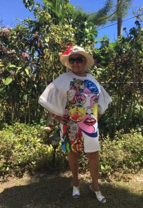 Kentucky Derby hat and bold print dress