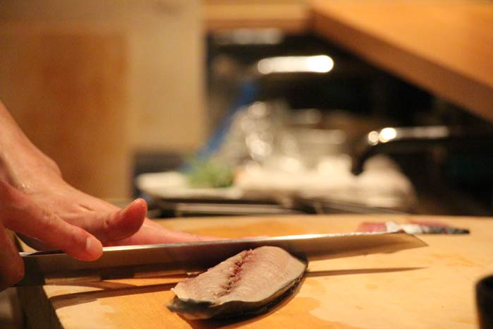 Cutting fish for Sashimi