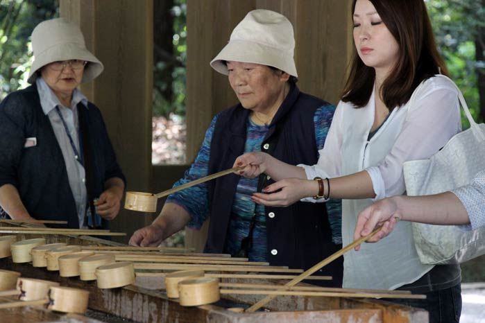Visitors of the Meiji Shrine washing their hands before praying