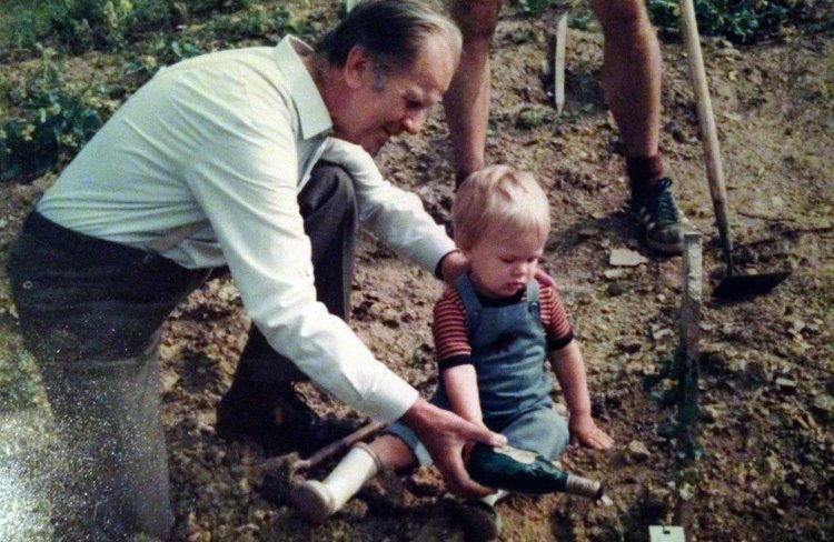 "My grandpa and I ""watering"" the last vine"