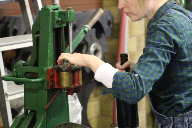 Putting corks in the corking machine