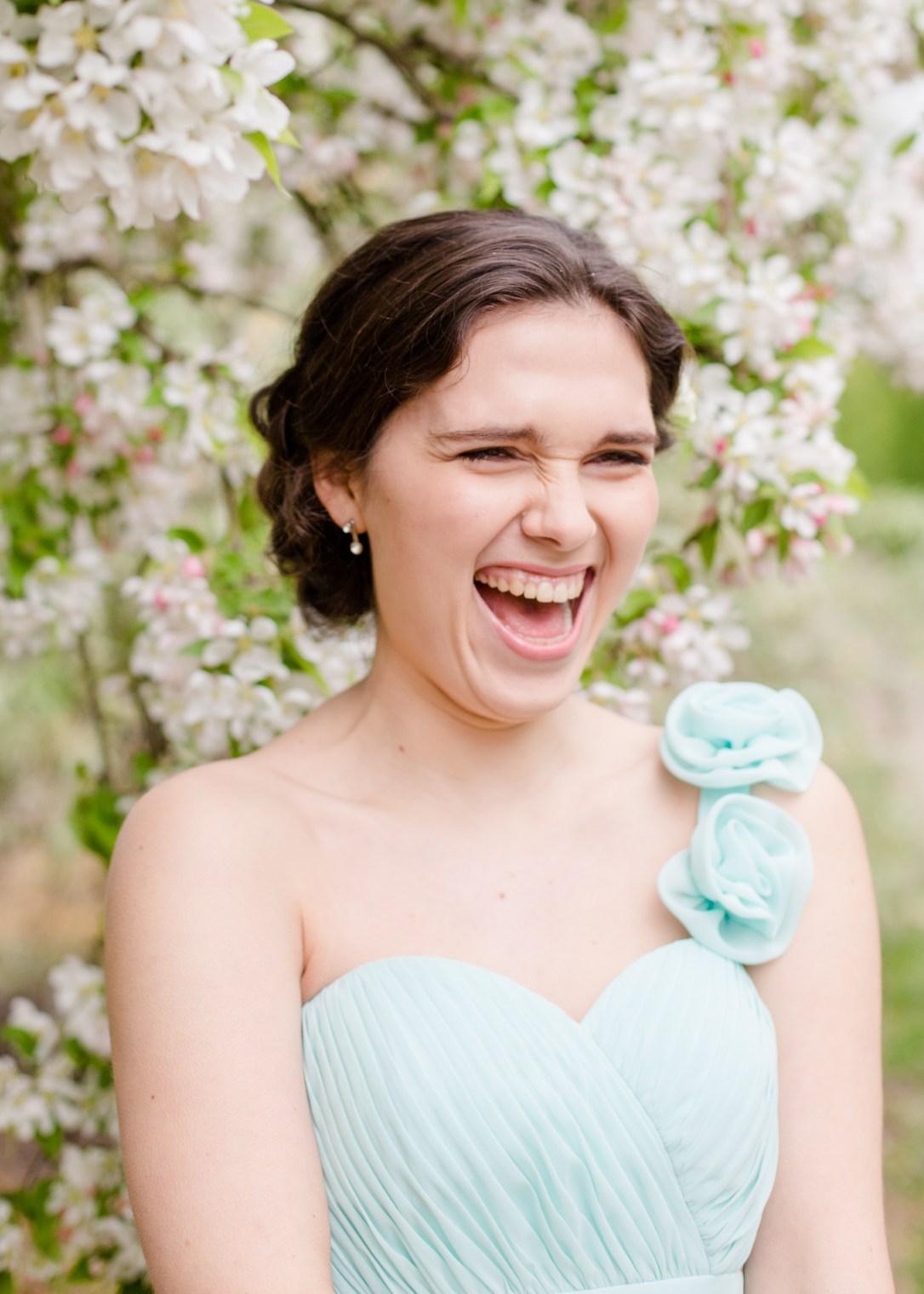 Adel laughing, pastel green bridesmaid dress