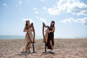Harp playing sisters harpists Adel and Karina on Sandgate beach