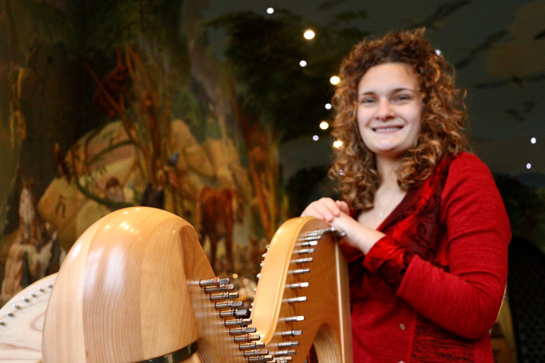 Wedding harpist smiling in Port Lympne Kent wedding venue