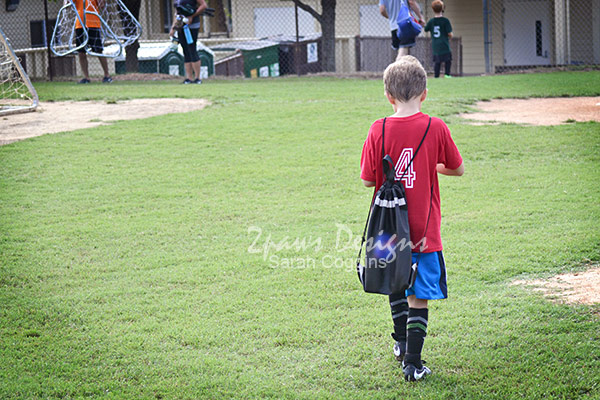 Soccer Player with Bag