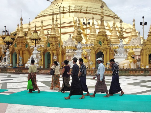 Ladies in skirts and men in longyi.