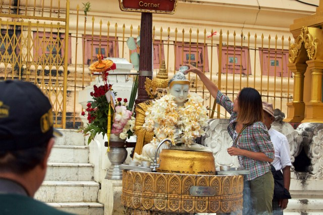 Pouring water on the Buddha for luck and prosperity.