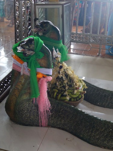 Two Great Snakes with various offerings.