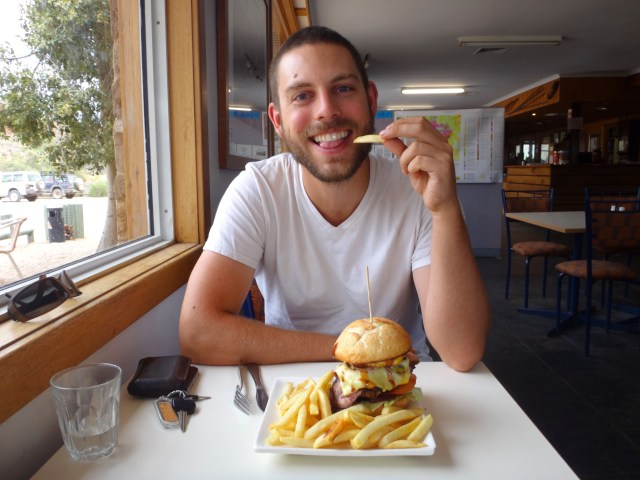 Chris being super excited about his roo burger.