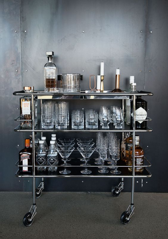 Steel bar cart with no greenery and glassware inline to give an industrial feel