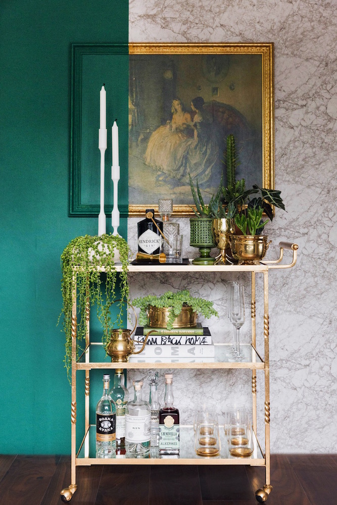 Gold bar cart with greenery and gold accents to complement the color blocked wall