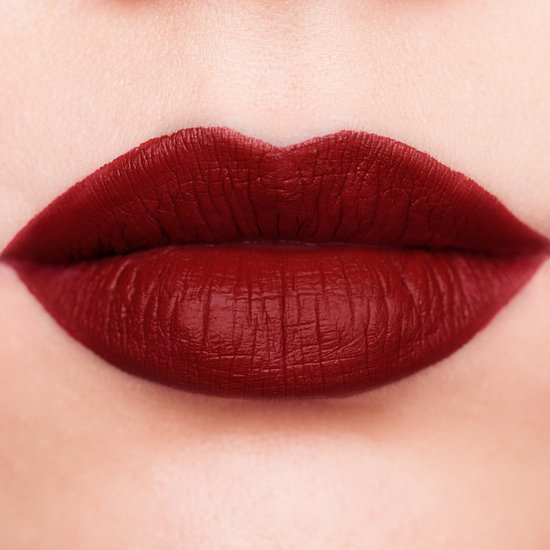 Jeffree Star Velour Liquid Lipstick in Unicorn Blood, a dark rusty matte red