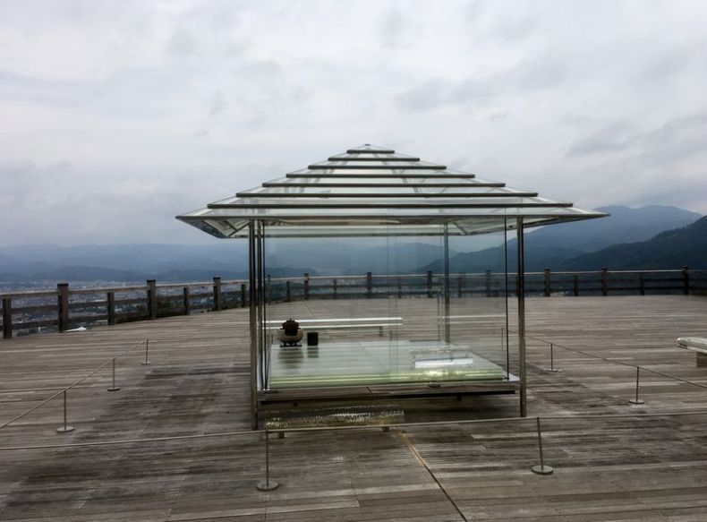 This image has an empty alt attribute; its file name is glass-tea-house.jpg