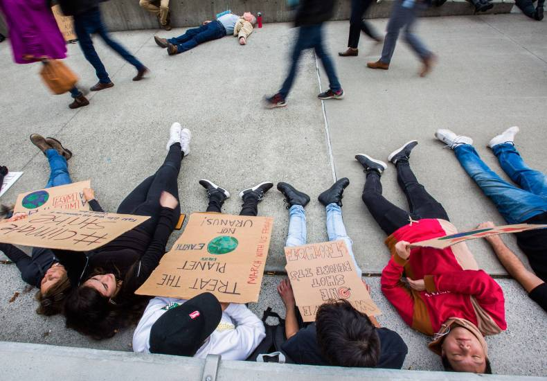Students from ACES Alternative High School in Mukilteo participate in the Die-In during the Global Climate Strike at the Snohomish County Campus Plaza on Sept. 20, 2019 in Everett. (Olivia Vanni / Herald file)