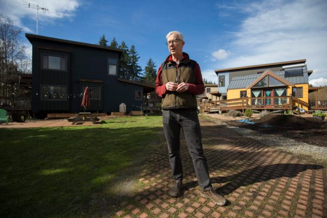 Tom Campbell, who as a legislative staffer helped write the original 1990 Growth Management Act, stands in the eco-friendly subdivision called Clearwater Commons in Bothell. (Andy Bronson / The Herald)