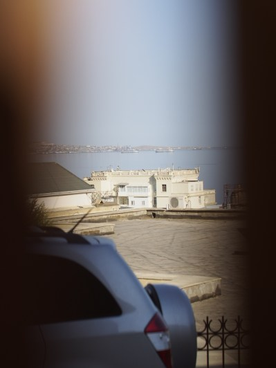 Our first glimpse of the Caspian - through the gates at the old palace. An SUV, naturally, is in the way.
