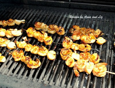 Best Grilled Shrimp and Scallop Kabobs grilling on a BBQ by 2sistersrecipes.com