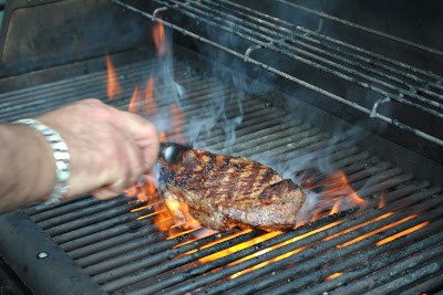 Grilling Steak on the Barbecue by 2sistersrecipes.com