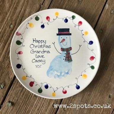 Snowman footprint plate with fingerprint fairylights
