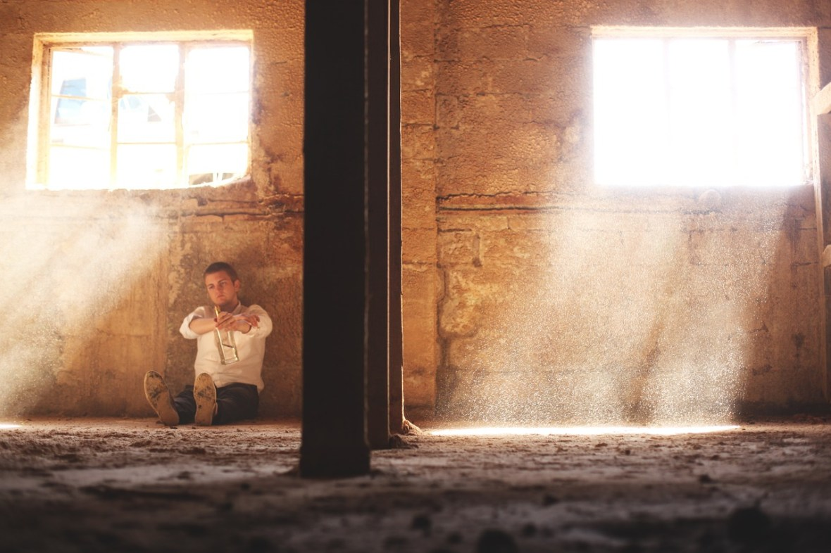 man sitting in cell_Free-Photos