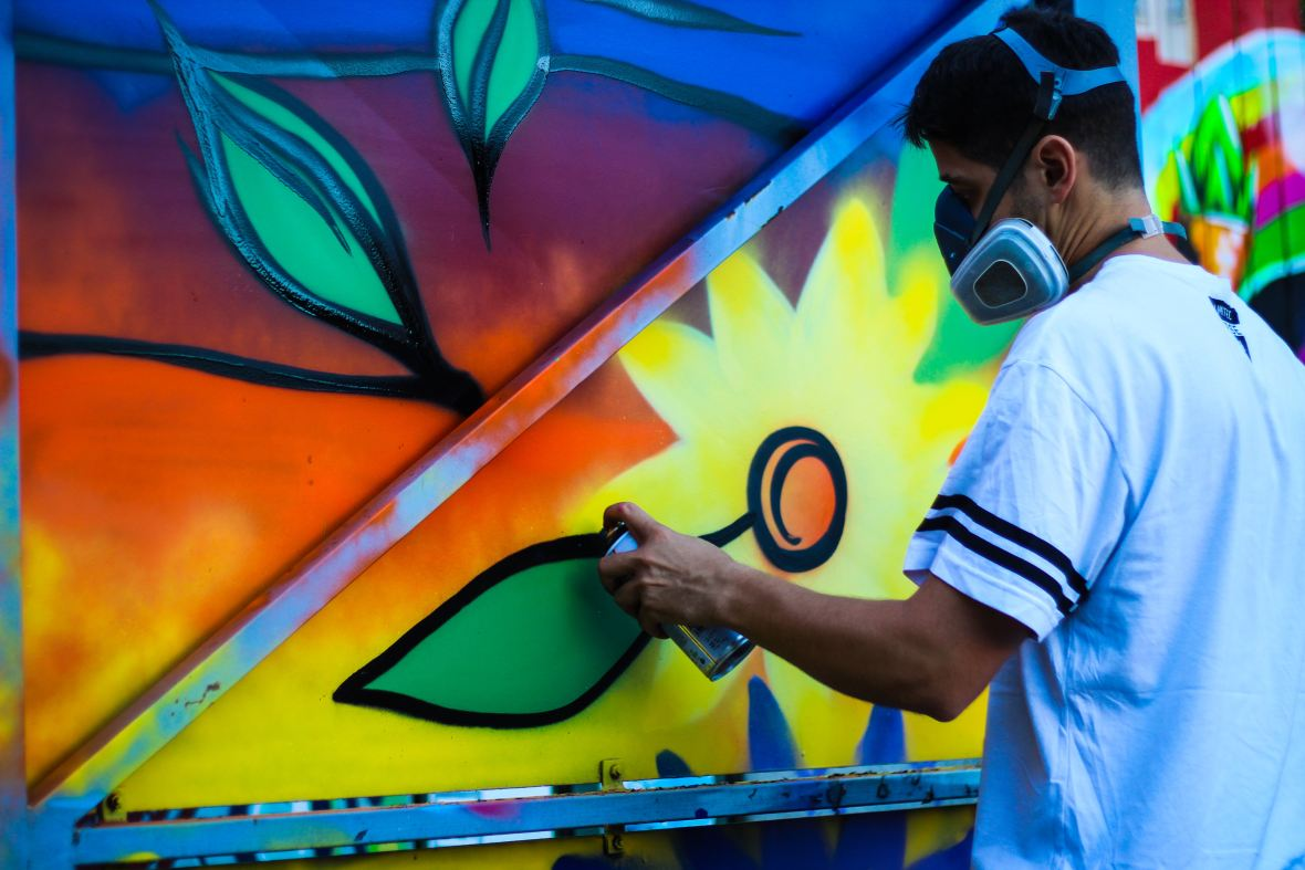 colourful photo of graffiti artist by Maxime Bhm via Unsplash