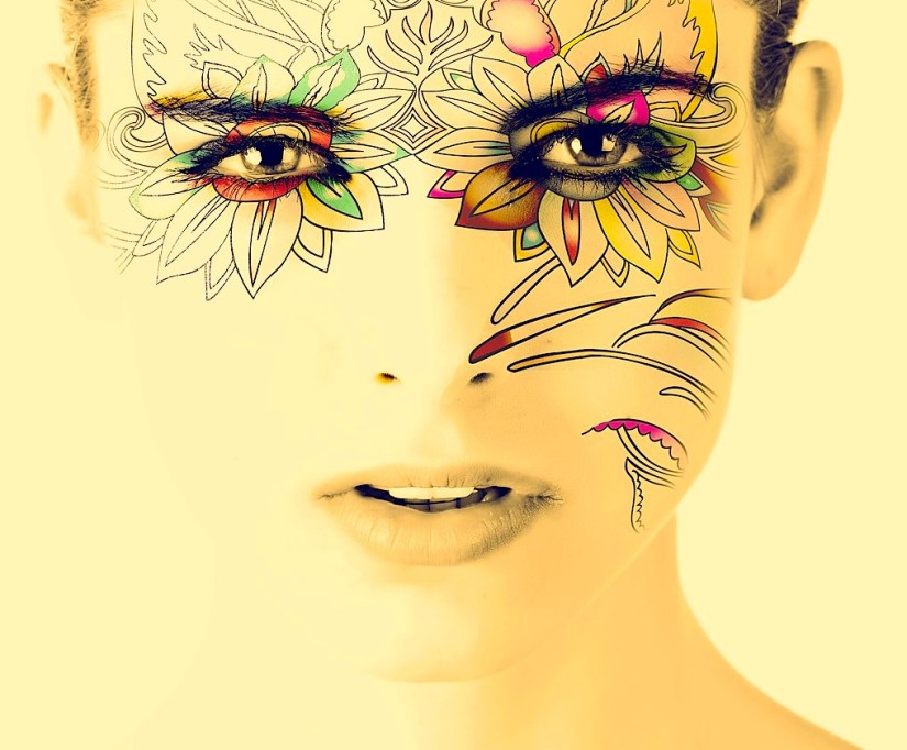 Woman's face with floral pattern around the eyes