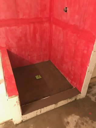 During -- Sealed backer board with concrete pan