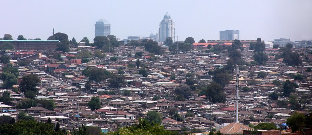 A view of the sprawling Alexandra Township with the Sandton skyline looming behind.