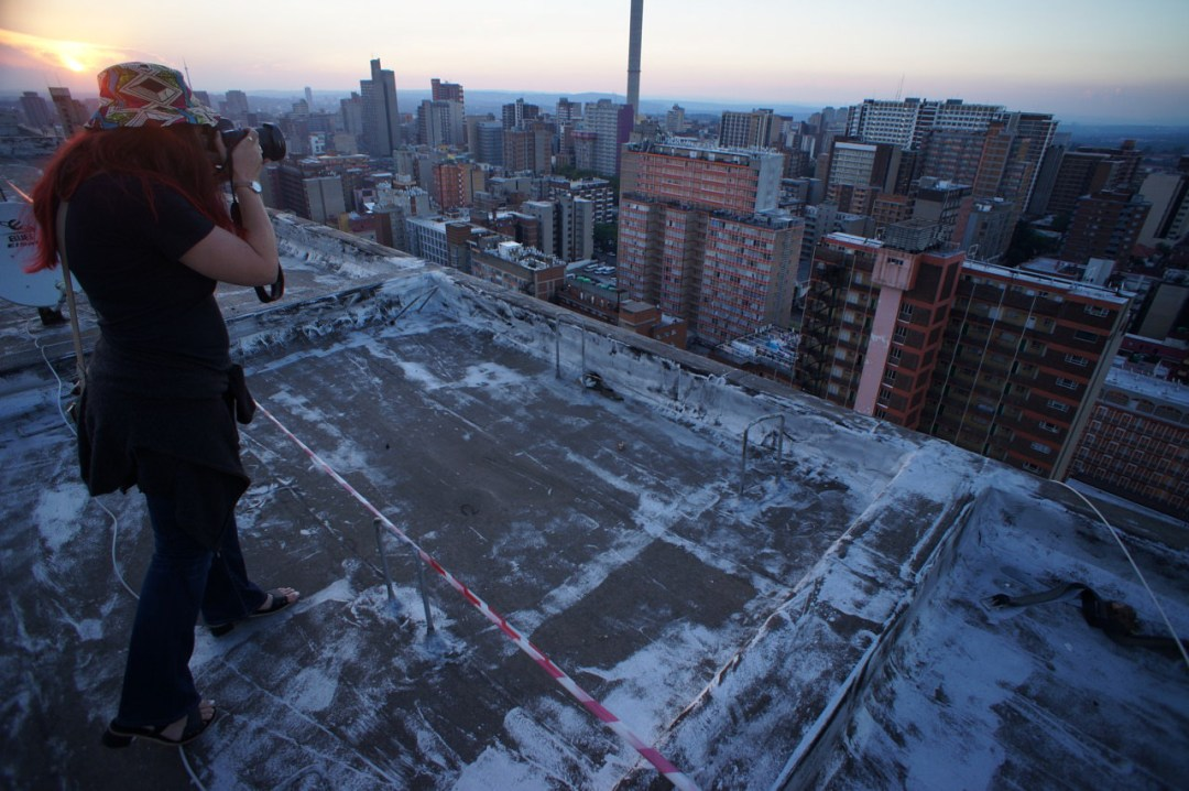 Heather photographs Hillbrow from the roof of the Tygerberg.