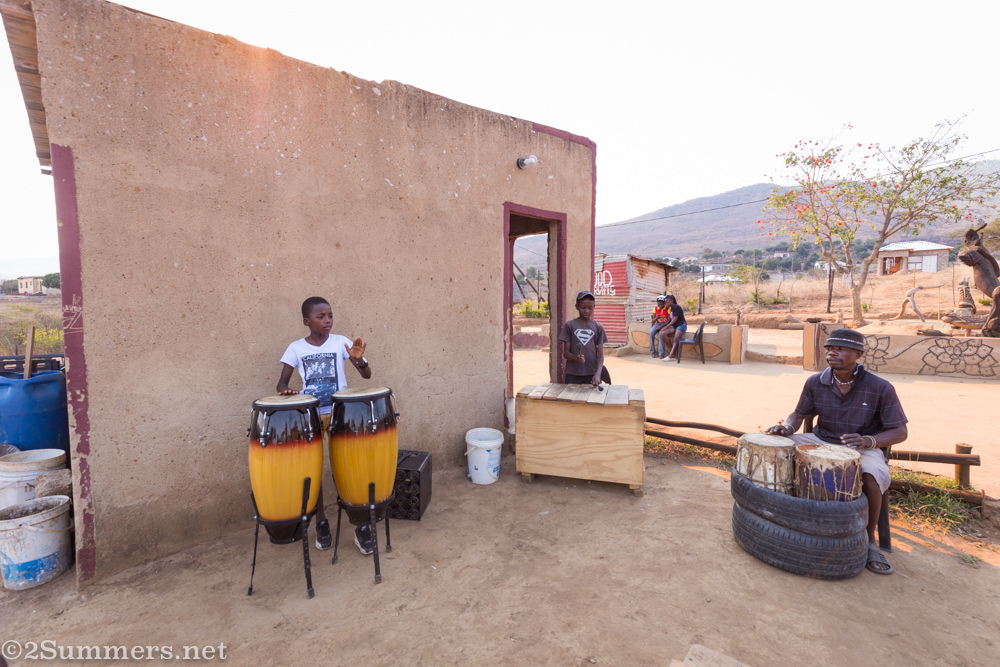 Kids playing music with Lucky Ntimani