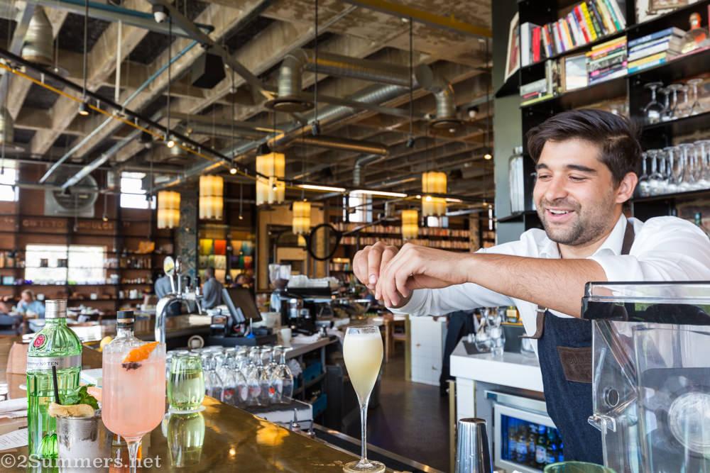 Bartender Dom de Lorenzo makes cocktails