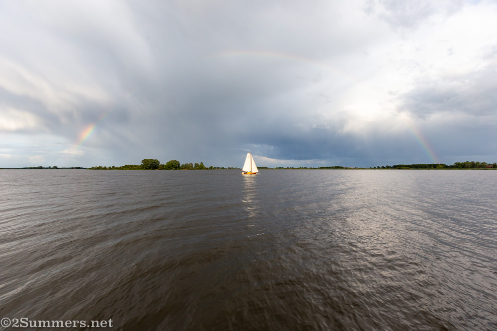 Sailboat and rainbow on a Netherlands canal