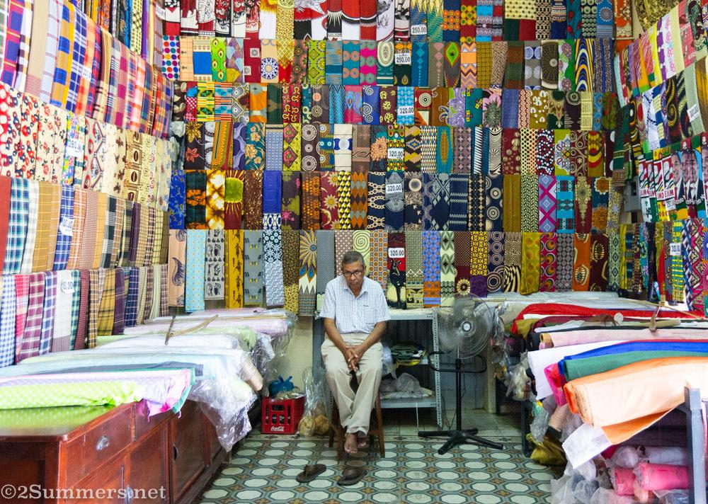 Man at Casa Elefante fabric shop in downtown Maputo.