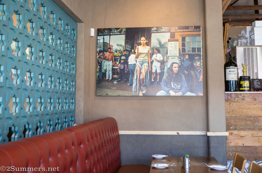 Photo of the Yeoville Ba-Pita hanging on the wall of the Melville Ba-Pita.