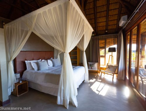 Bedroom in the deluxe suite at Mhondoro Safari Lodge